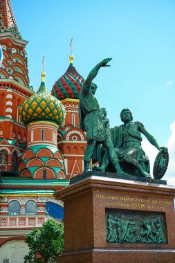 Monument to Minin and Pozharsky on the background of St. Basil's Cathedral on Red Square