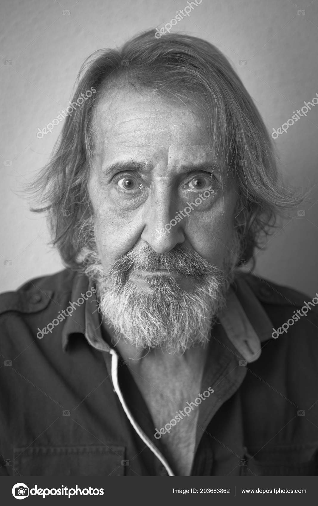 Black and white portrait of old man with long hair and beard photo by