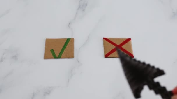 decision taking concept, hand with cursor icon in front of multiple choice green tick and cross signs selecting the Yes option