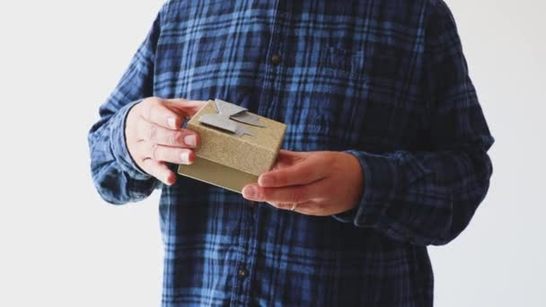 presents or surprises man opening golden gift box