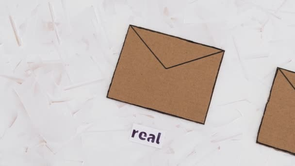 trust-worthy vs fake emails or online scams concept, email envelop icons with real vs fake labels on them and camera panning around the scene