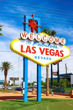 The Welcome to Fabulous Las Vegas sign on bright sunny day in Las Vegas.Welcome to Never Sleep city Las Vegas, Nevada Sign with the heart of Las Vegas scene in the background.