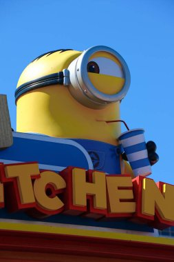 OSAKA, JAPAN - June 24, 2017 : Statue of HAPPY MINION, located in Universal Studios Japan, Osaka, Japan. Minions are famous character from Despicable Me animation.