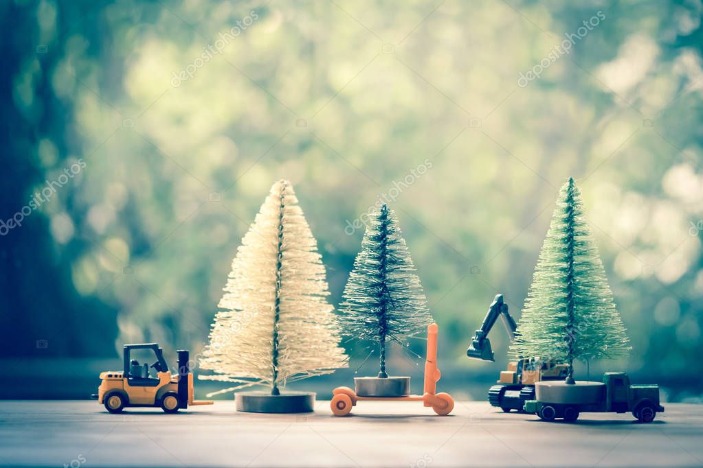 Excavator and forklift toy model move Christmas tree