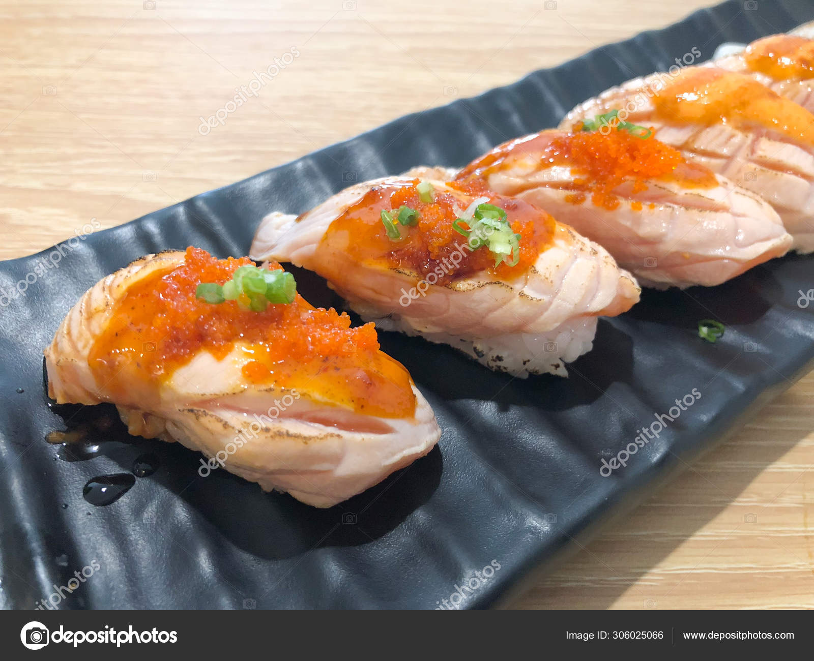 Grilled Salmon Sushi Set Of Salmon Sushi Topped With Sweet Sauce And Salmon Roe Traditional Japanese Food Stock Photo C Dontree 306025066