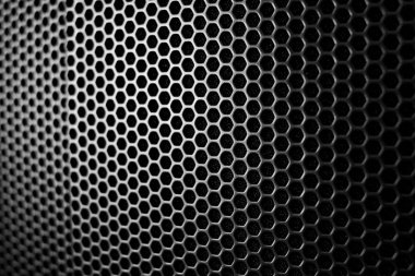Satin and black metal grid macro protecting an amplifier as a wallpaper