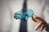 Fotografie Car rental service concept. Businessman hand car