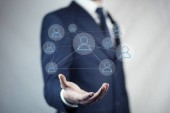 Fotografie young businessman with  social network icon over hand