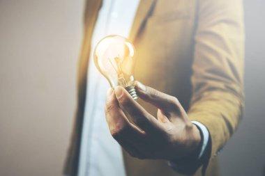 idea  light bulb in hand. Concept