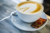 Perfect cup of cappuccino on white marble counter