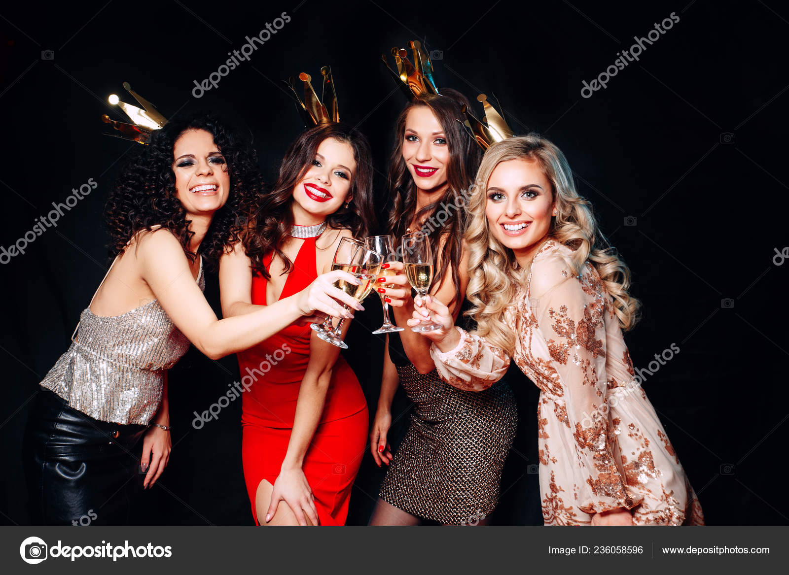 96d4a3bb7ee Four young beautiful women together celebrating party — Stock Photo ...
