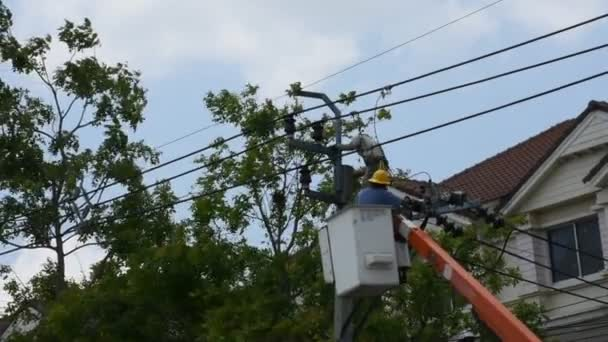 Electrician worker of Metropolitan Electricity Authority work repair electrical system on electricity pillar or Utility pole on April 21, 2018 in Nonthaburi, Thailand