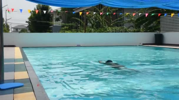 Thai fat men swim and playing in water at swimming pools of sports club at outdoor on November 22, 2018 in Nonthaburi, Thailand