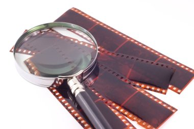 Color photographic film and magnifying glass to see the details