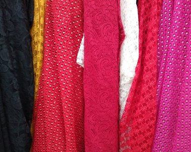Rolls of fabric sold in the store