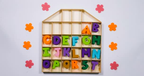 The English alphabet disappears and appears in the cells of the house.
