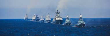 A line of modern russian military naval battleships warships in the row, northern fleet and baltic sea fleet in the open se