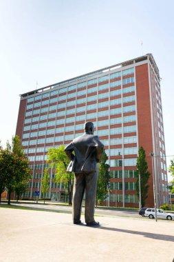 Tomas Bata statue with skyscraper 21, Zlin, Moravia, Czech Republic