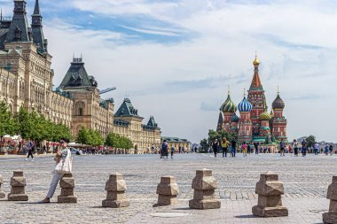 Moscow, Russia, 07.13.2020. View of Red square, GUM store, St. Basil's Cathedral, people walking around the square