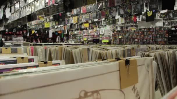Music paraphernalia shop with poster, shirts, etc.