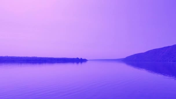 the sky is purple from the sunset ,time over lake.