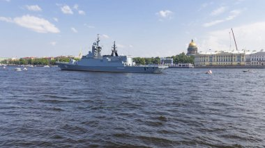 St. Petersburg - August 12, 2018: a large anti-submarine ship Soprovidelny on the parade in honor of the day of the Navy against the backdrop of the St. Isaac's Cathedral August 12, 2018, St. Petersburg, Russia