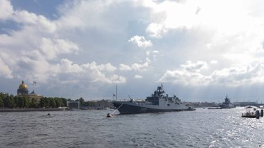 St. Petersburg - August 12, 2018: Ships and Frigate Admiral Makarov at a parade in honor of the Navy Day against the backdrop of St. Isaac's Cathedral August 12, 2018, St. Petersburg, Russia