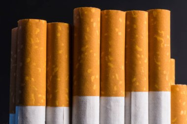 Close up pack of filtered cigarettes. Quitting smoking is the single easiest way to avoid heart disease