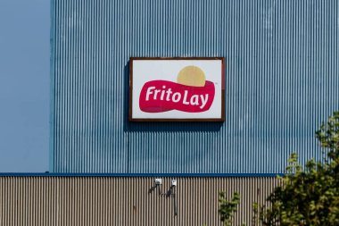 Frankfort - Circa August 2018: Frito-Lay snack food plant. Frito-Lay is a subsidiary of PepsiCo that manufactures chips and other salty foods III