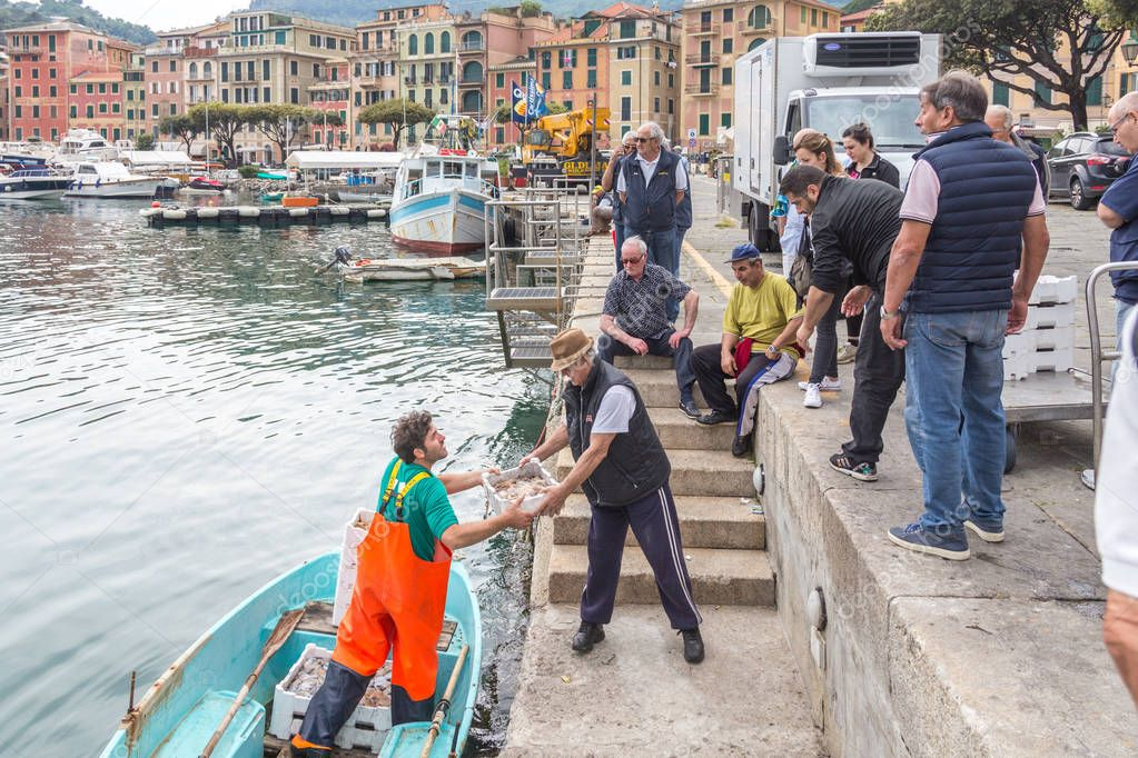 SANTA MARGARITA , ITALY - MAY 08, 2018: Fishermen selling their seafood catch to restaurant owners