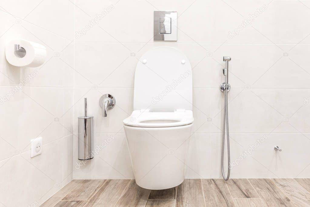 Toilet bowl in modern white hitech bathroom