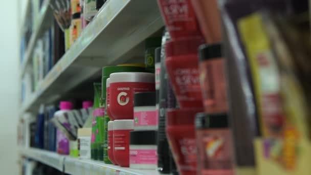 Woman choosing facial cosmetics in the store