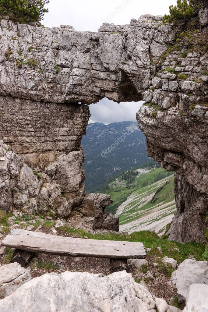 View of the mountains from rock window in Loser peak. Dead Mountains (Totes Gebirge) in Austrian Alps