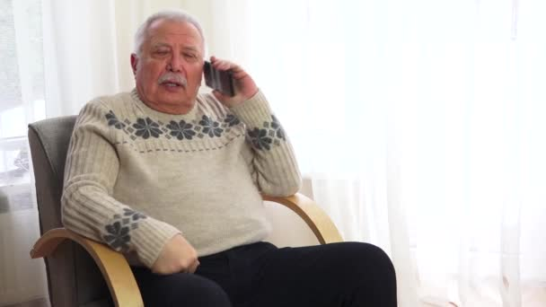 old man with grey moustache has serious talk with doctor