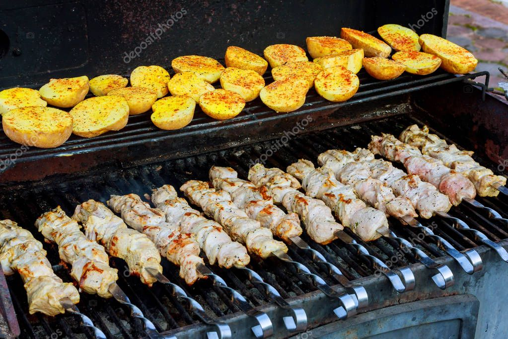 Tasty grilled meat with meat kebabs with potatoes