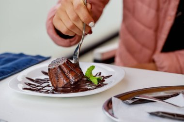 Hot homemade individual chocolate fondant brownie in spoon