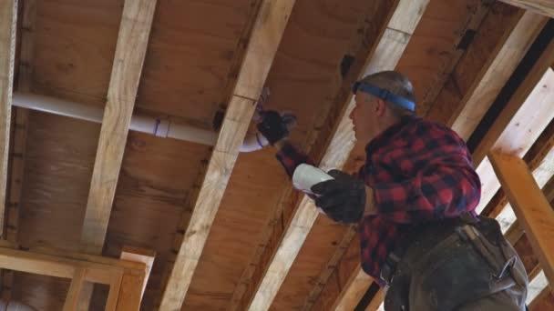 Men plumber glued plastic toilet white pipe in close-up shot