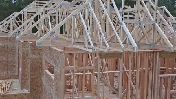 Close-up new stick built home under construction under blue sky Framing structure wood frame of wooden houses home.