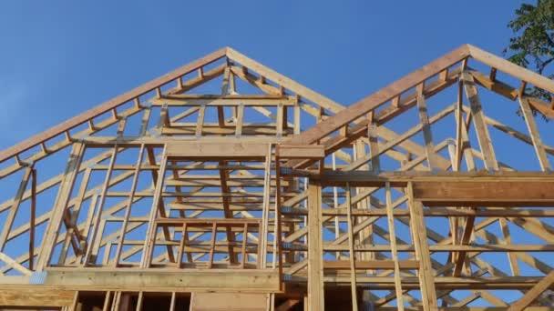 Stick built home under construction under blue sky framing structure wood frame of wooden houses home.