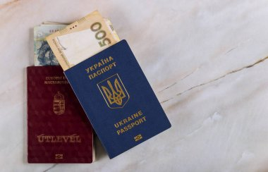 Passports of dual citizens Ukraine and Hungarian for traveling Concept on the Ukrainian and Hungarian money national grivna , foreigncurrency