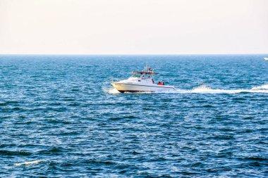 Luxury yacht speeding on Arabian sea in Dubai, United Arab Emirates