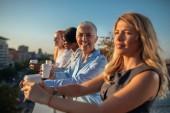 Photo of successful business women enjoying drinking coffee at break.