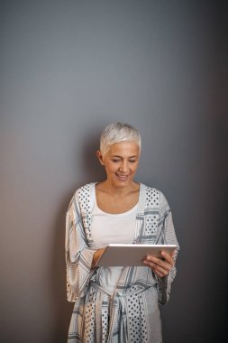 Mature woman holding a tablet