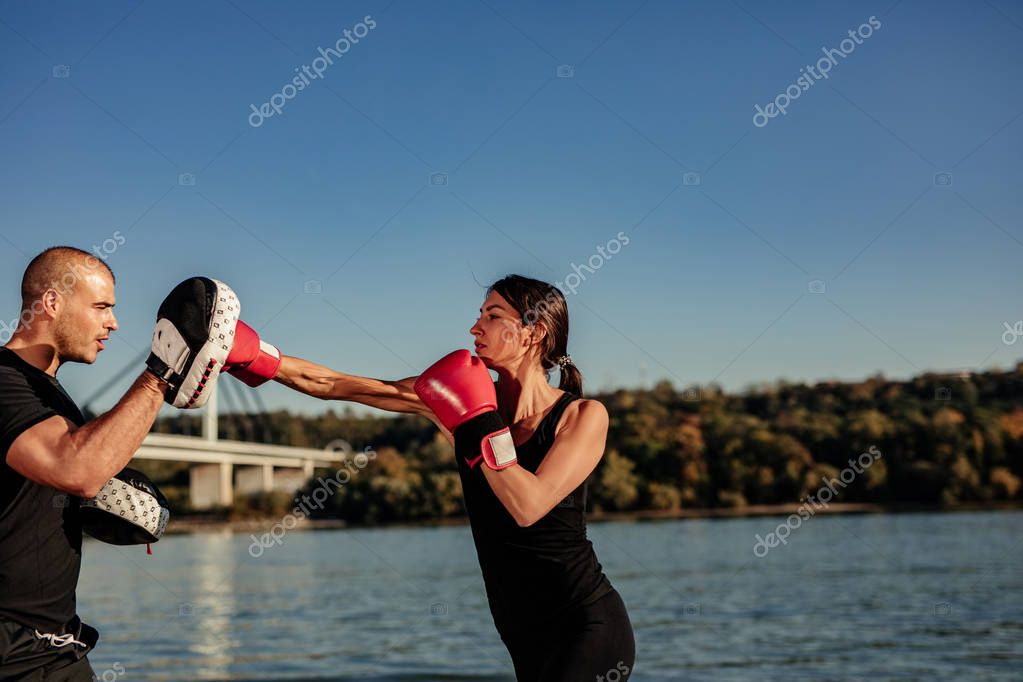 Shot of a boxer training oudoors