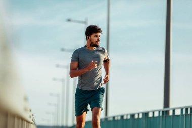 Athlete man running outdoors.