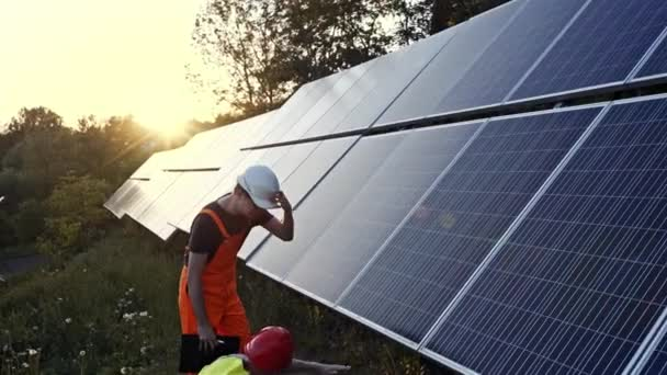Two technicians or engineers checking solar panels