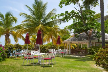 Antigua, Caribbean islands - May 20, 2019: English Harbour Hotel, Galeon beach, sun beds and umbrellas neat the pool