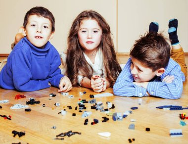 funny cute children playing toys at home, boys and girl smiling, first education role close up, lifestyle people concept