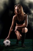 Photo young athletic girl with a soccer ball