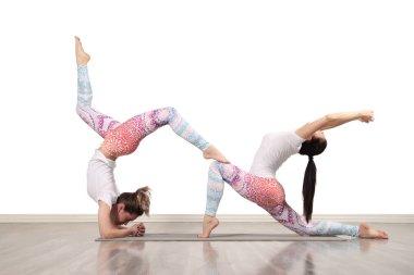 Young female acrobats make beautiful acrobatic poses